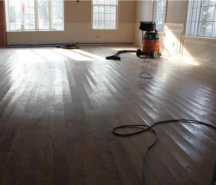 slightly cupped oak floorboards cleared the room of furnishings