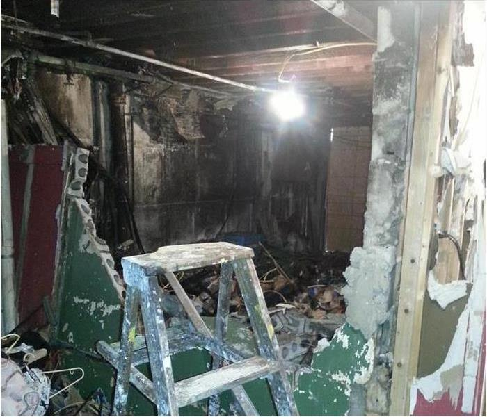 burned interior, destruction of cinder block walls in the basement